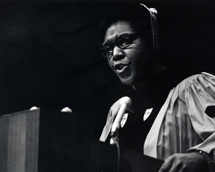Barbara Jordan standing at a podium in doctoral regalia.jpeg