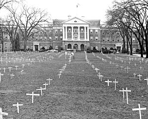 "University of Wisconsin–Madison - Bascom Hill, 1968, with crosses placed by students protesting the Vietnam War, and sign reading, ""Bascom Memorial Cemetery, Class of 1968"""