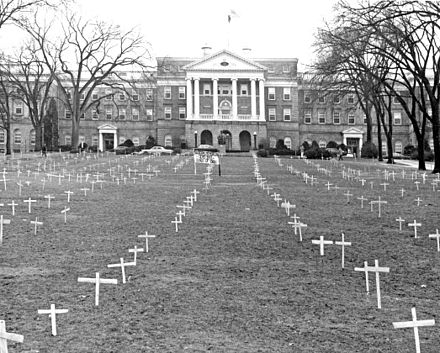 "Bascom Hill, 1968, with crosses placed by students protesting the Vietnam War, and sign reading, ""Bascom Memorial Cemetery, Class of 1968"" Bascom Hill crosses2.jpg"