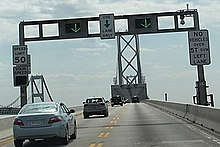 Electronic signs indicate vehicles are moving the correct direction on the bridge