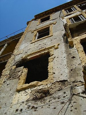 A war-damaged building in Beirut, still unrepa...