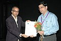 Bhupendra Khaintola felicitated the Director, Shri Mahesh Ramanathan- Chief Operating Officer (Big Pictures), at the presentation of the film (PAA), during the IFFI-2010, in Panjim, Goa on November 28, 2010.jpg