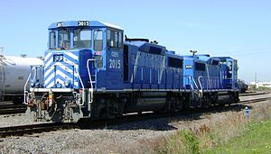 Two EMD GP20D's in the CEFX scheme. Note that both hoods are lowered