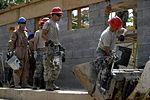 Bond beam work at Gabriela Mistral School construction site 150622-F-LP903-012.jpg