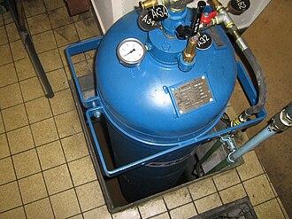 Compressed air energy storage - A pressurized air tank used to start a diesel generator set in Paris Metro