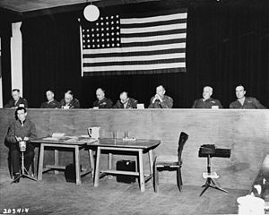 Buchenwald Trial - The eight American officers of the U.S. military tribunal at the trial of former camp personnel and prisoners from Buchenwald. From left to right: Lt. Col. Morris, Col. Robertson, Col. Ackerman, Brig. Gen. Kiel, Lt. Col. Dwinell, Col. Pierce, Col. Dunning, and Lt. Col. Walker.