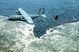 "133rd Airlift Wing - C-130E dropping U.S. Army paratroopers during the ""Rodeo 92"" airdrop competition at Pope Air Force Base, NC in 1992"