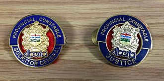 Alberta Sheriffs Branch - Court and Prisoner Security cap badges, reflecting ministry changes through the years.