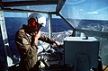 CAPT John D. Moulton, a member of the helicopter detachment assigned to the Canadian frigate HMCS MARGAREE (DDH-230), talks with the pilot of an incoming helicopter from the ship's - DPLA - fcd710cc55d1662692a3583df1939503.jpeg