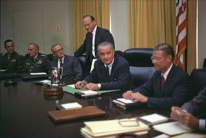 Presidency of Lyndon B. Johnson - July 1965 cabinet meeting, seated (L-R): Marine Corps Commandant Gen. Wallace M. Greene, Army Chief of Staff Gen. Harold Keith Johnson, Army Secretary Stanley Rogers Resor, National Security Advisor McGeorge Bundy (standing), Johnson, and Defense Secretary Robert McNamara