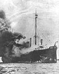 Cargo ship USS Ophir (ID 2800) burning at Gibraltar in November 1918.jpg