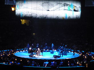"Carolina in My Mind - Taylor performs ""Carolina in My Mind"" during his 2010 Troubadour Reunion Tour with Carole King. The video screen shows scenes of a countryside."
