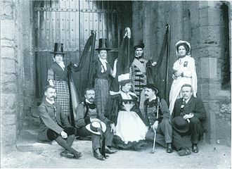 Celts (modern) - Delegates at the Pan-Celtic Congress, Caernarfon, 1904. Back row: Maggie Jones (harpist of Arfon); Mrs Gruffydd Richards (chief harpist of Gwent), David Roberts (blind harpist of Mawddwy), Gwyneth Vaughan. Front row: Pedwr James, Émile Hamonic, Léna Botrel, Théodore Botrel, Professor Paul Barbier