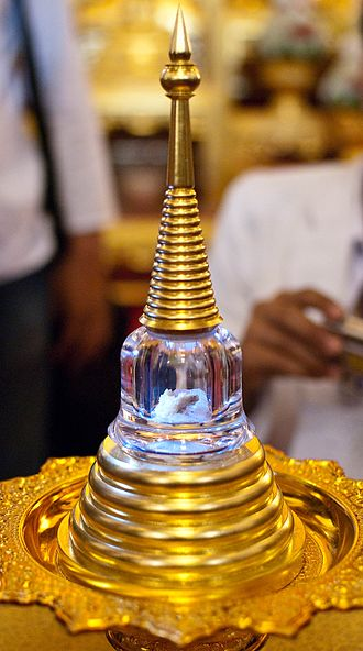 A relic found amid the ashes of Chan Kusalo (the Buddhist Patriarch of Northern Thailand) is placed inside a chedi shaped vial and displayed inside Wat Chedi Luang in Chiang Mai. Chan Kusalo cremation 51.jpg