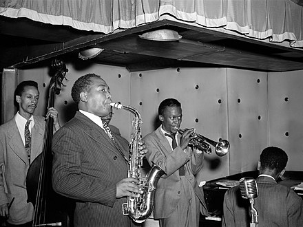 Parker with (from left to right) Tommy Potter, Max Roach, Miles Davis, and Duke Jordan, at the Three Deuces, New York, circa 1945 Charlie Parker, Tommy Potter, Miles Davis, Duke Jordan, Max Roach (Gottlieb 06851).jpg