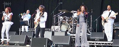 "The Sugarhill Gang used disco band Chic's ""Good Times"" as the source of beats for their 1979 hip hop hit ""Rapper's Delight"". Pictured is Chic at a 2012 concert. Chicgf.JPG"