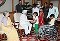 Children tying 'Rakhi' to the Prime Minister, Dr. Manmohan Singh, on the occasion of 'Raksha Bandhan', in New Delhi on August 21, 2013. Smt. Gursharan Kaur is also seen.jpg