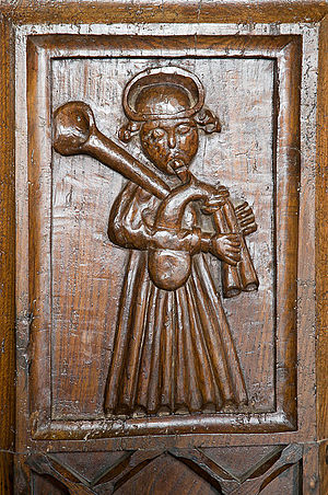 Cornish bagpipes - Cornish Piper on a bench end at Davidstow church