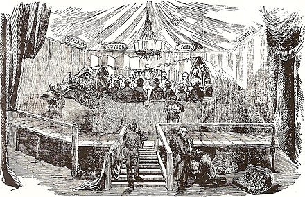 The famous banquet in the mould of the Crystal Palace Iguanodon, New Year's Eve, 1853 Crystal palace iguanodon.jpg