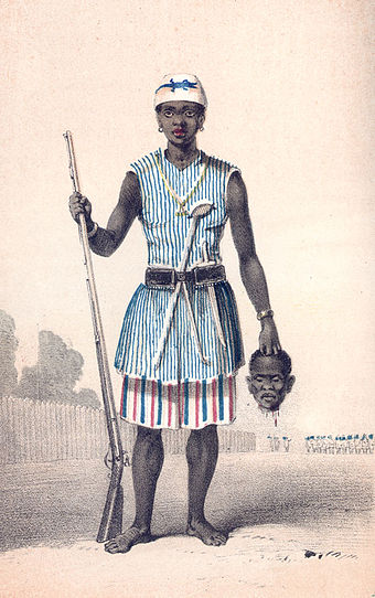 Seh-Dong-Hong-Beh, leader of the Dahomey Amazons, holding a severed head. Dahomey amazon1.jpg