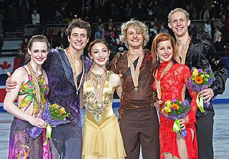 2009 Four Continents Figure Skating Championships - The ice dancing podium. From left: Tessa Virtue / Scott Moir (2nd), Meryl Davis / Charlie White (1st), Emily Samuelson / Evan Bates (3rd).