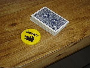 "A dealer button or ""buck"" next to a ..."
