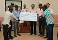 Defence Minister Manohar Parrikar felicitating the fishermen who helped save an Indian Navy pilot.jpg