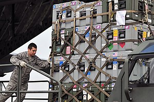 Cargo net - Loading cargo secured within a cargo net