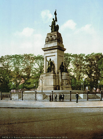 The Hague Center - Plein 1813 (Square 1813) with a monument commemorating the founding of the Kingdom of the Netherlands, as seen on a photochrom from ca. 1900.