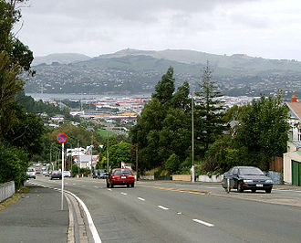 Caversham, New Zealand - From Lookout Point, Caversham Valley Road descends rapidly. This image shows the view east across South Dunedin to Otago Harbour, with Otago Peninsula in the background.