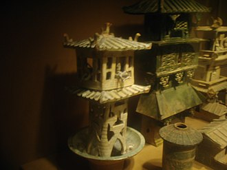 Zhang Heng - Eastern Han tomb models of watchtowers; the one on the left has crossbowmen in the top balcony. Zhang wrote that Western Han emperors were entertained by displays of archery from the balconies of towers along Chang'an's Kunming Lake.