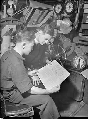 Edward Preston Young - Edward Young (right) and Telegraphist S Stain reading HMS/M Storm newspaper Good Evening