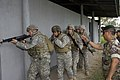 El Salvador Army 1st Sgt. Jose Hernandez, from the El Salvador Special Forces Anti-Terrorist Special Command, right, gives the go-ahead to a team of soldiers of the U.S. Army's 1st Battalion, 325th Airborne 060502-A-CL600-023.jpg