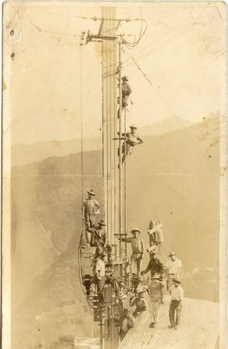 San Juancito, Honduras - Men on the tower of the hydroelectric power plant.