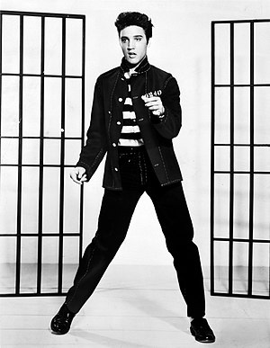 Slim-fit pants - Elvis Presley wearing drainpipe jeans. In the 1950s, the waist was higher than on modern skinny jeans.