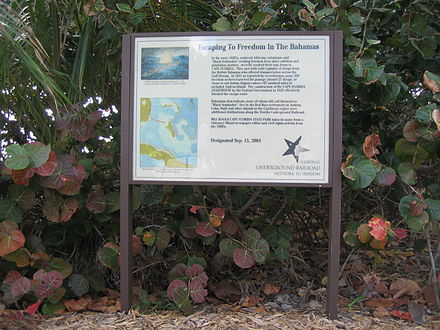 Sign at Bill Baggs Cape Florida State Park commemorating hundreds of African-American slaves who escaped to freedom in the early 1820s in the Bahamas. Escaping To Freedom In The Bahamas sign 01.jpg