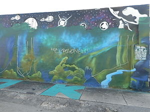 "Wynwood Art District - Letters of ""war"" spray painted over space picture and oversprayed with ""FC preserved"""