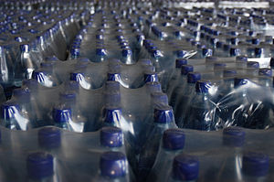 English: Cases of water bottles used for disas...