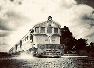 Fábrica Argentina de Locomotoras - A Justicialista diesel locomotive at   a level crossing, 1952.