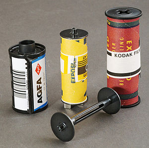 127 film - 127 film (center, with spindle) sits between 35mm (left) and 120 roll film (right) formats in terms of size