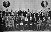 A formative shot of politicians in three row of about 12 each, with two more portraits inset