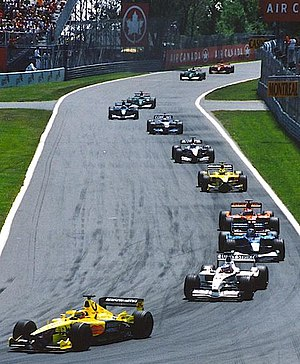 Jarno Trulli - Trulli leads the midfield on the first lap of the 2001 Canadian Grand Prix.