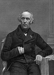 Litografi av portrettet av en sittende mann som glir venstre hånd inn i jakken