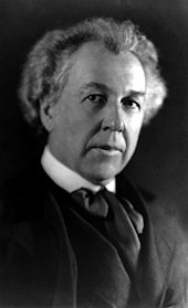 Black and white portrait photo of a white male with light hair