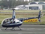 G-OTJS Robinson Raven 44 Helicopter Kuki Helicopter Sales Ltd (29118935924).jpg