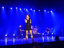 Garbage performing in a stage.
