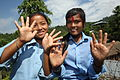 Girls wash their hands at a water source at a NEWAH WASH water project in Puware Shikhar, Udayapur District, Nepal. (10698175334).jpg