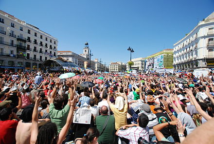 Puerta del Sol square in Madrid, shown here on 20 May 2011, became a focal point and a symbol during the protests. Go Spanish revolution - Indignados.jpg