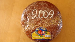 Vasilopita New Years Day bread or cake in Greece and many other areas in eastern Europe and the Balkans which contains a hidden coin or trinket which gives good luck to the receiver