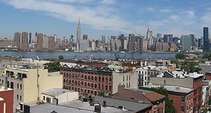 View of Greenpoint's East River waterfront and Manhattan in background.